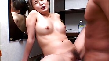 Asian babe made to ride a big black cock